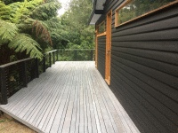 Contrasting Alis grey stain on the deck with the black Alis on the weatherboards.