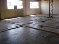 Warehouse - Before (glued tiles stuck directly on timber).