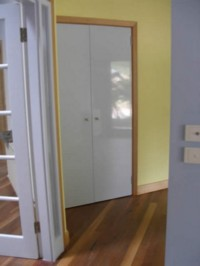 Doors and frame treated with Vindo #629 natural oil paint, white gloss. Walls with Sunny Yellow #410.