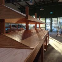 Ply shelving stands treated with the Kunos white at an organic grocer